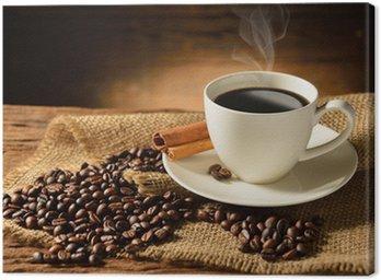 Obraz na Płótnie Filiżanka kawy i ziarna kawy na starym drewnianym tle