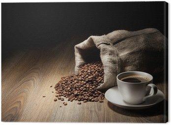 Obraz na Płótnie Filiżanka kawy z konopie worek z palonych ziaren na rustykalną tabeli