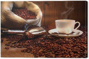 Obraz na Płótnie Filiżanka kawy z konopie worek z palonych ziaren