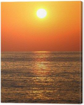 Obraz na Płótnie Głęboki kolor pomarańczowy zachód słońca na plaży