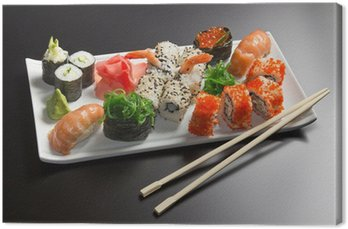 Obraz na Płótnie Japońskie sushi owoce morza, roll i chopstick na białym talerzu