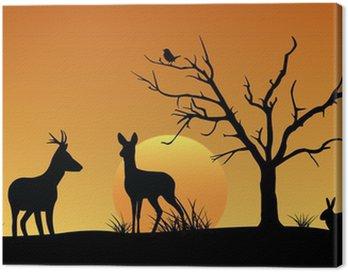 Obraz na Płótnie Jelenie, zające, ptaki, zachód słońca sylwetka