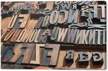 Obraz na Płótnie Kilka starych zabytkowych drewnianych liter drukarskich bloku prasowych.