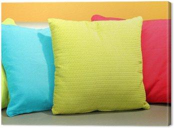 Obraz na Płótnie Kolorowe poduszki na kanapie, na żółtym tle