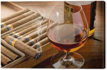 Obraz na Płótnie Kubańskich cygar i butelka koniaku na tle drewna