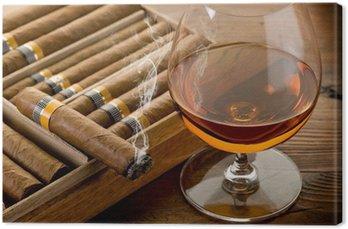Obraz na Płótnie Kubańskie cygara i koniak na tle drewna