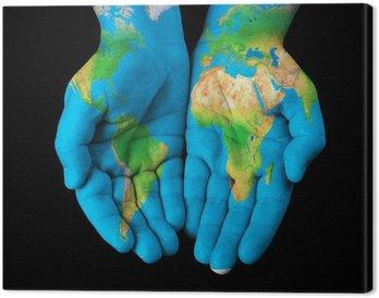 Obraz na Płótnie Mapa malowane na ręce pokazano koncepcji - Świat w naszych rękach