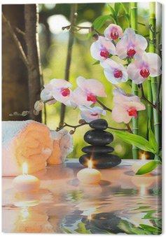 Obraz na Płótnie Masaż skład spa z świece, orchidee, kamienie w ogrodzie