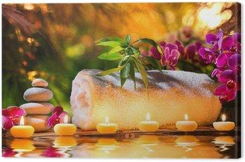 Obraz na Płótnie Masaż spa w ogrodzie - świece i wodę