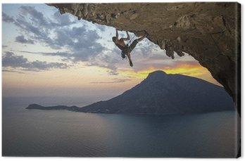 Obraz na Płótnie Mężczyzna alpinistą o zachodzie słońca. Kalymnos Island, Grecja
