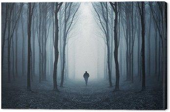 Obraz na Płótnie Mężczyzna w ciemnym lesie