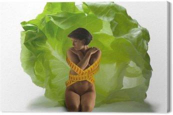 Obraz na Płótnie Młoda kobieta z sałatą 01