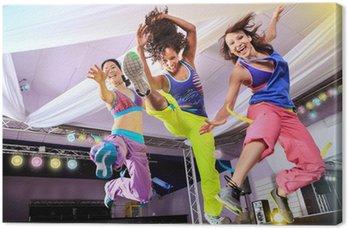 Obraz na Płótnie Młodych kobiet w sporcie sukni skoków w warunkach tlenowych i zumba Exerc
