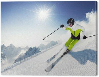 Obraz na Płótnie Narciarz w górach, przygotowany piste i słoneczny dzień