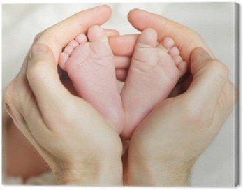 Obraz na Płótnie Noworodek - nogi w ręce ojca