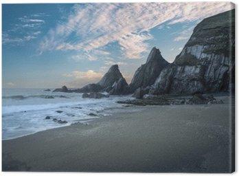 Obraz na Płótnie Oszałamiająca kolorowe słońca na plaży krajobraz z postrzępionych skał f