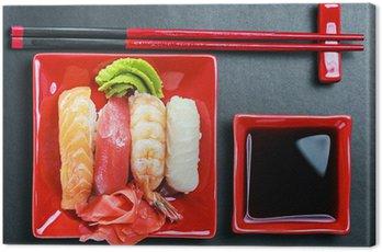 Obraz na Płótnie Owoce morza sushi i pałeczkami na czerwonym tablicy