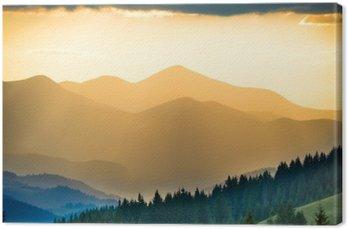 Obraz na Płótnie Piękny zachód słońca w górach