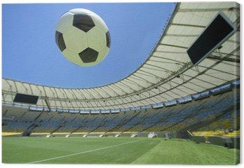 Obraz na Płótnie Piłka nożna Piłka nożna Flying Over Stadion Zielony boiska
