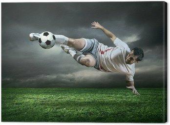 Obraz na Płótnie Piłkarz z piłką na zewnątrz w deszczu działań w ramach