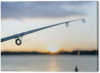 Obraz na Płótnie Połowów na jeziorze przed zachodem słońca