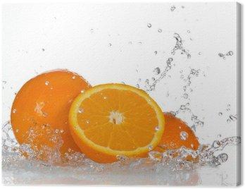 Obraz na Płótnie Pomarańczowe owoce i plusk wody