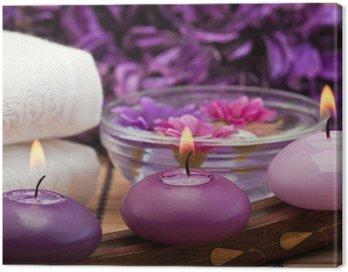 Obraz na Płótnie Purpurowe świece i kwiaty w otoczeniu Spa (1)