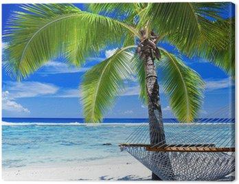 Obraz na Płótnie Pusty hamak między palmami