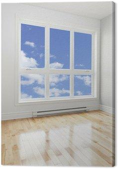Pusty pokój i błękitne niebo widziane przez okno