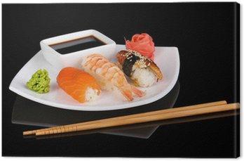 Obraz na Płótnie Pyszne sushi serwowane na tablicy wyizolowanych na czarny
