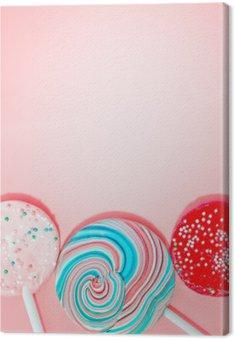 Obraz na Płótnie Różowe tło z kolorowymi Cukierki