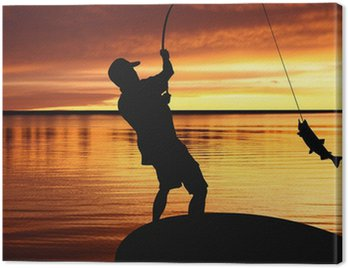 Obraz na Płótnie Rybak z połowu ryb na tle wschód słońca
