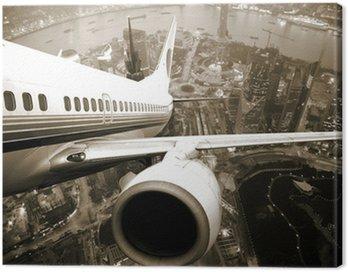 Obraz na Płótnie Samolot startu z miasta nocą.