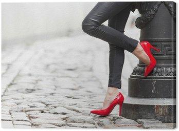 Obraz na Płótnie Sexy nogi w czarne skórzane spodnie i czerwone buty wysoki obcas