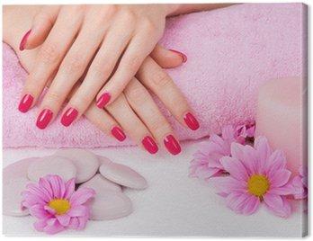 Obraz na Płótnie Spa manicure z różowymi kwiatami, kamieniami i świeca