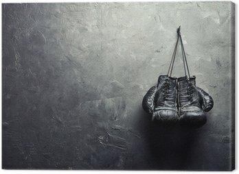 Obraz na Płótnie Stare rękawice bokserskie powiesić na gwoździu na ścianie tekstury