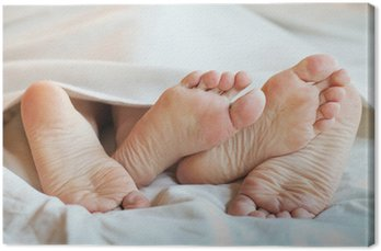 Obraz na Płótnie Stopy para w łóżku