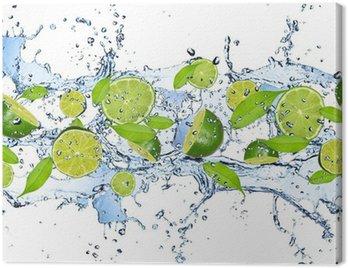 Obraz na Płótnie Świeże limes w plusk wody, na białym tle