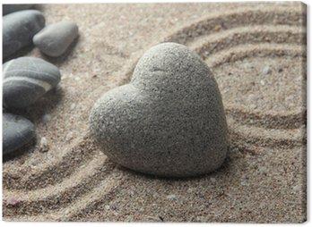 Obraz na Płótnie Szary zen kamień w kształcie serca, na tle piasku