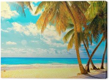 Obraz na Płótnie Sztuka Piękny zachód słońca nad morzem z widokiem na palmy na wh