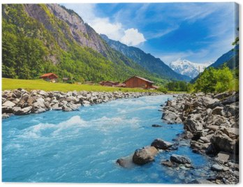 Obraz na Płótnie Szwajcarski krajobraz z rzeki strumienia i domy