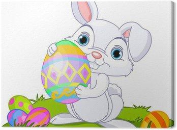 Obraz na Płótnie Wielkanoc. Bunny prowadzenia jajko