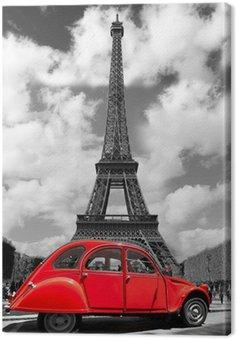 Wieża Eiffla z czerwonym starym samochodem w Paryżu, Francja