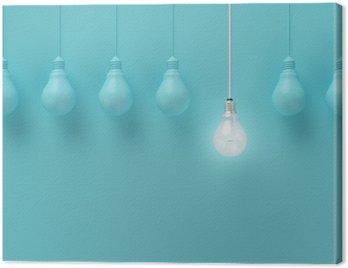 Obraz na Płótnie Wiszące żarówki świecące jeden inny pomysł na jasnoniebieskim tle, minimalne pojęcie idei, płaskiej nieprofesjonalnych, górnym