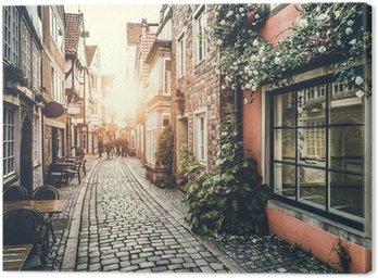 Obraz na Płótnie Zabytkowej ulicy w Europie na zachód słońca z efektu retro vintage