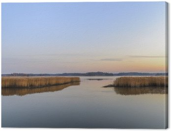 Obraz na Płótnie Zachód słońca i spokojne morze
