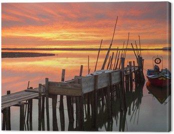 Obraz na Płótnie Zachód słońca na molo i rzemieślniczego holmoak rybackiej