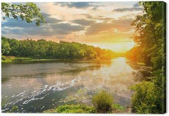 Obraz na Płótnie Zachód słońca nad rzeką w lesie