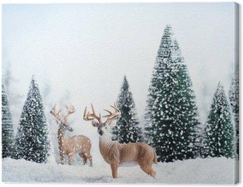 Obraz na Płótnie Zimowy krajobraz z jelenie, śnieg i jodły.