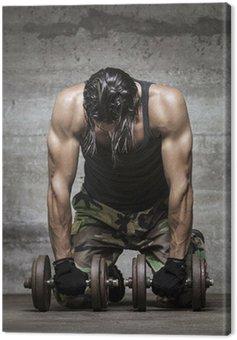 Obraz na Płótnie Zmęczony sportowiec mięśni